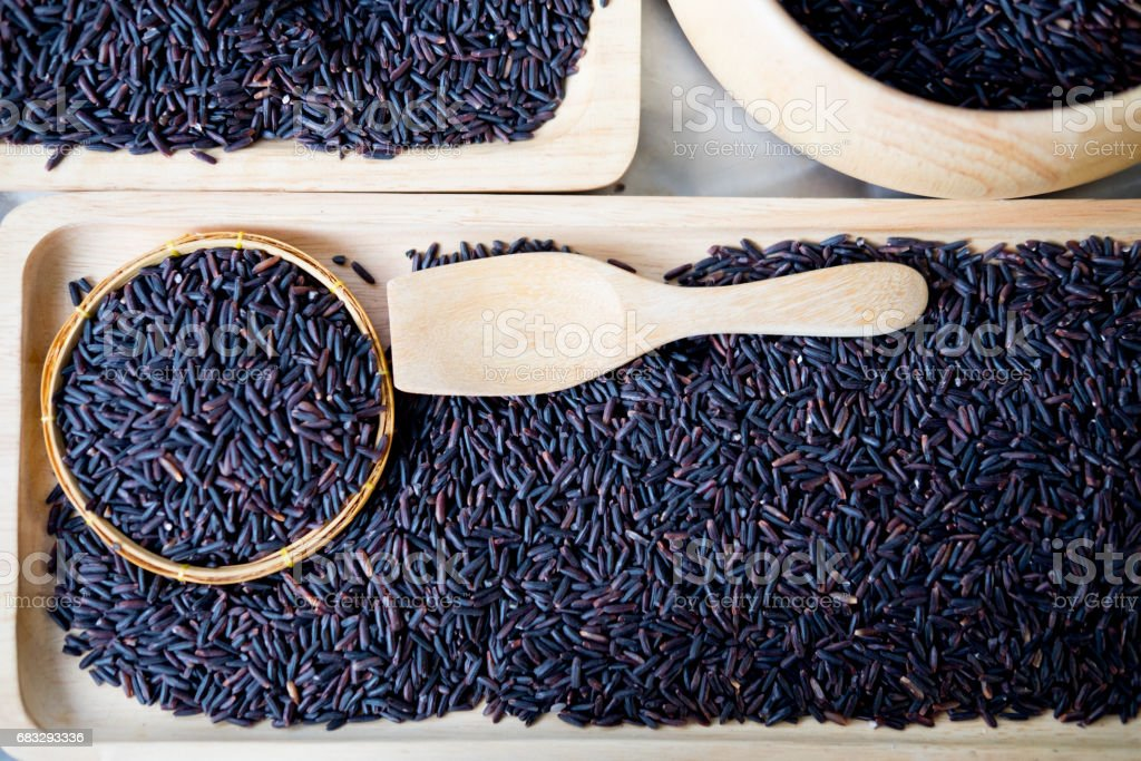 Black jasmine rice or organic riceberry rice, ready for cook stock photo