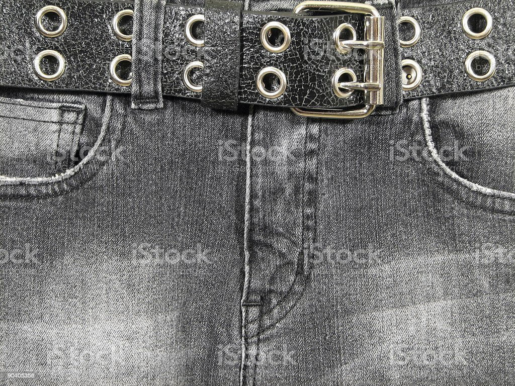 Black jeans, leather belt royalty-free stock photo