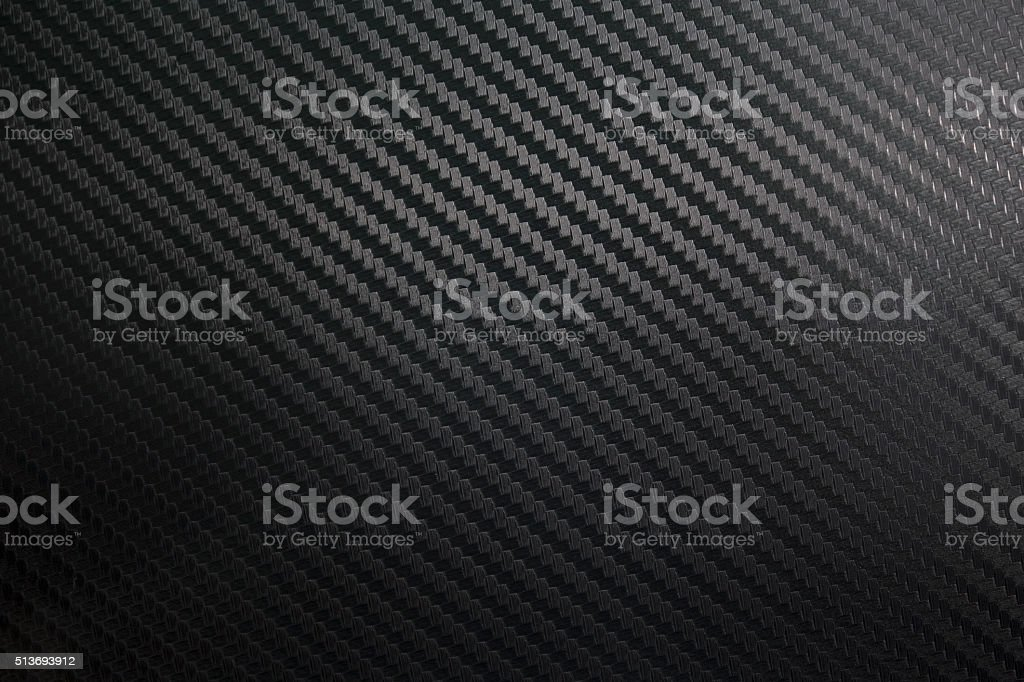 Black Kevlar carbon fibre background stock photo
