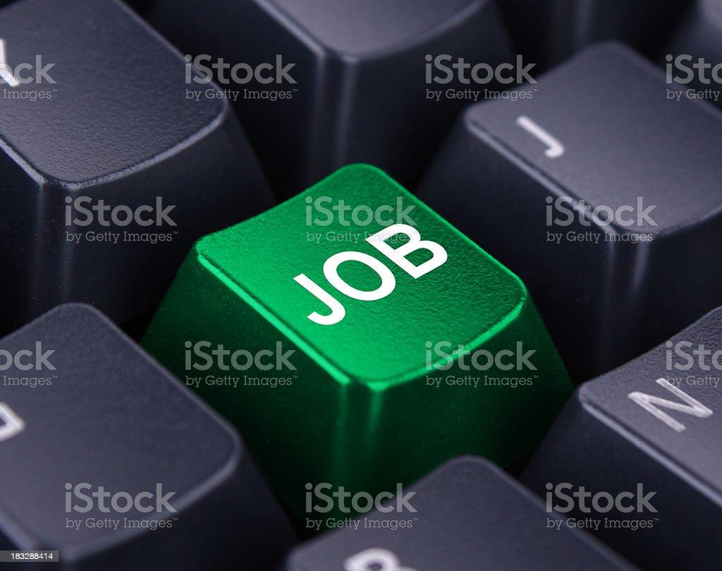Black keyboard with a green job key stock photo