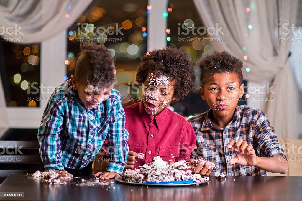 Black kids smashed a cake. stock photo