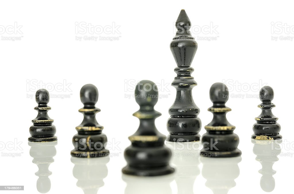 Black king protected with pawns royalty-free stock photo