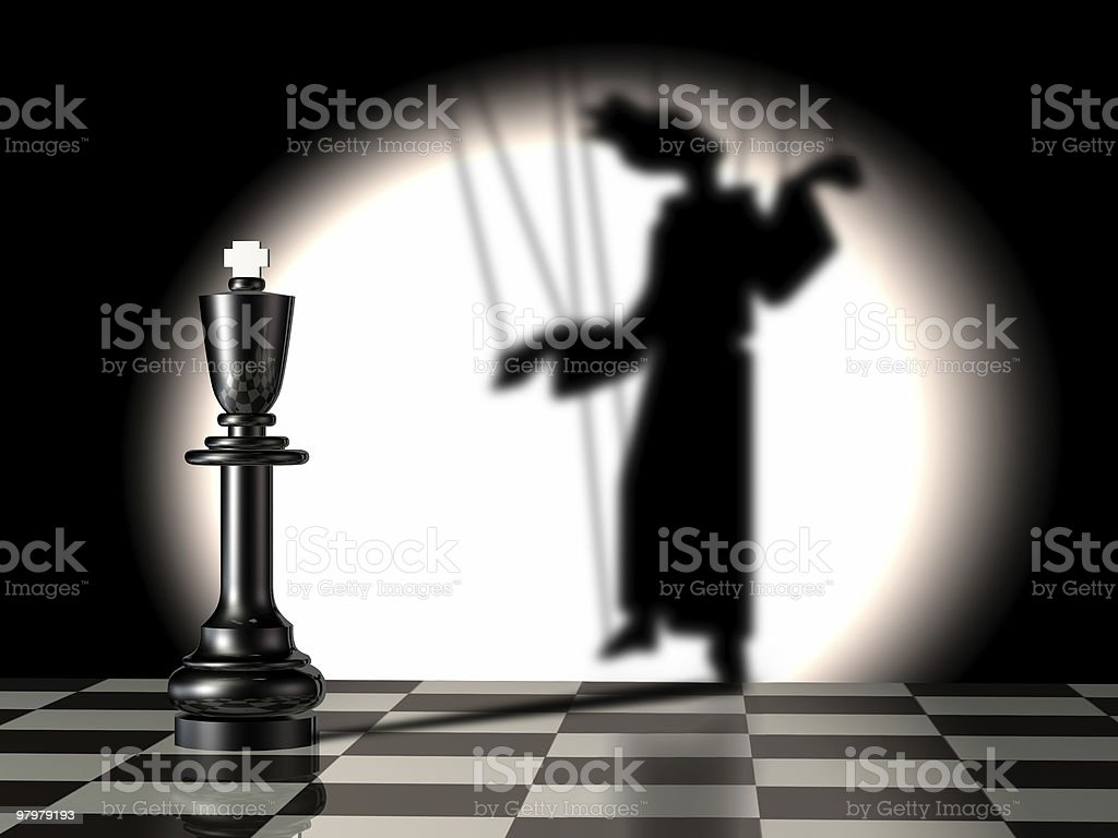 Black king with puppet's shadow stock photo