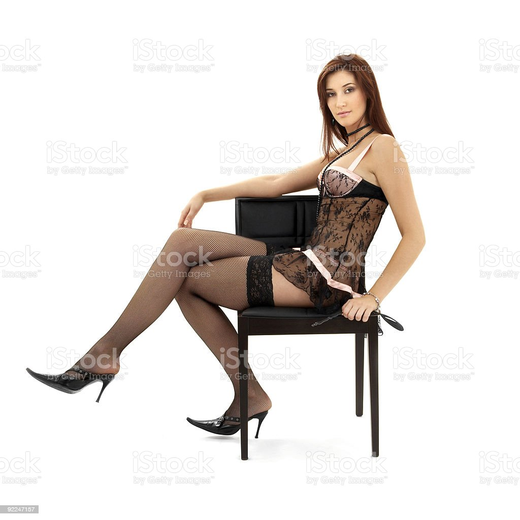black lace brunette in chair with mask royalty-free stock photo