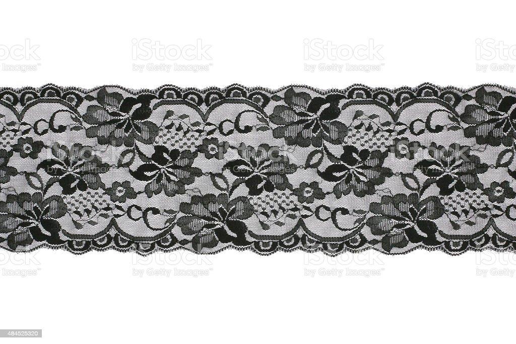 Black lace on white background stock photo