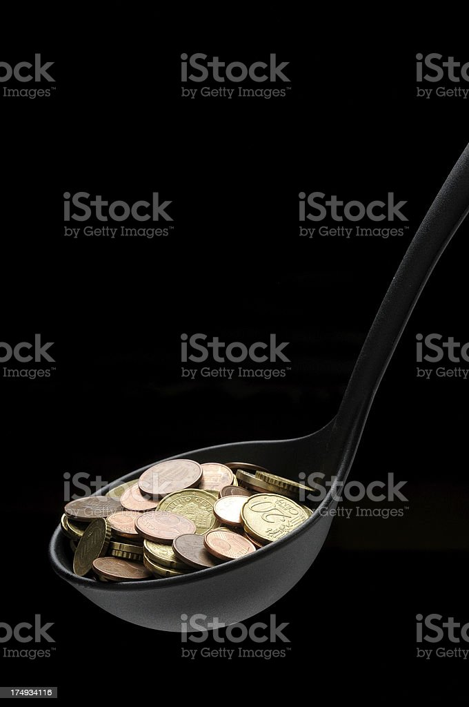 Black Ladle Containing Money stock photo