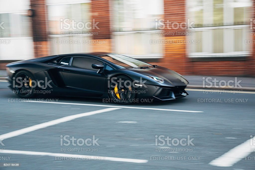 Black Lamborghini sports car in motion stock photo