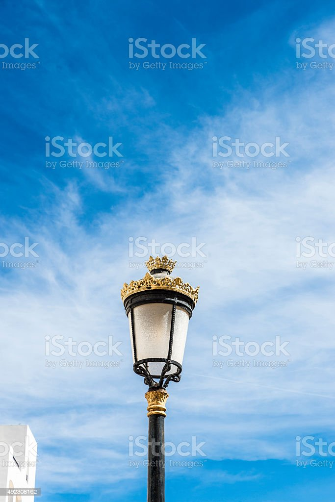 Black lamppost with golden ornaments stock photo
