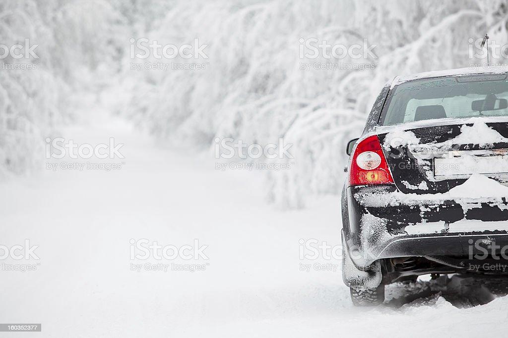 Black land vehicle standing on winter road stock photo