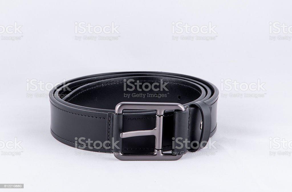 Black leather belt isolated on white background stock photo
