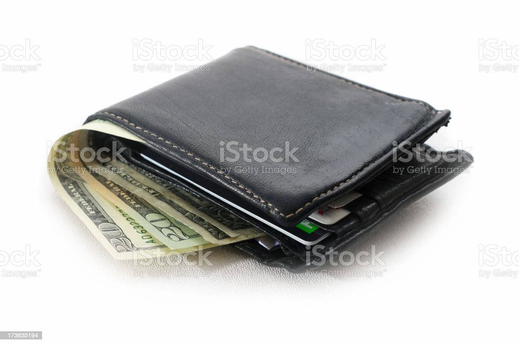 A black leather bi-fold wallet with cash and cards stock photo