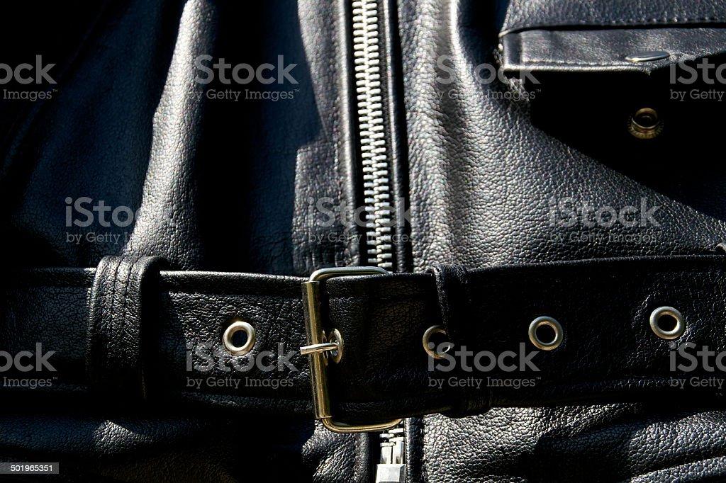 black leather biker jacket belt zipper and pocket stock photo