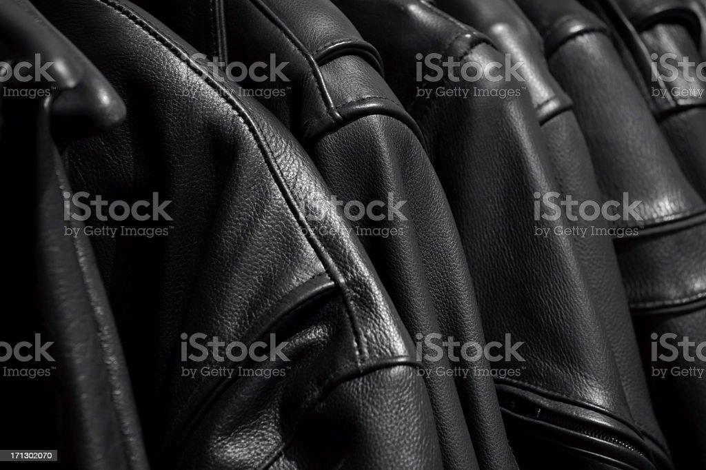 Black leather biker jackets. stock photo