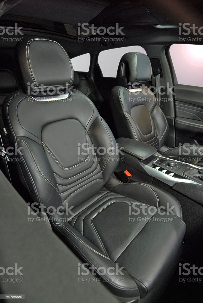 Black leather front SUV car seats stock photo