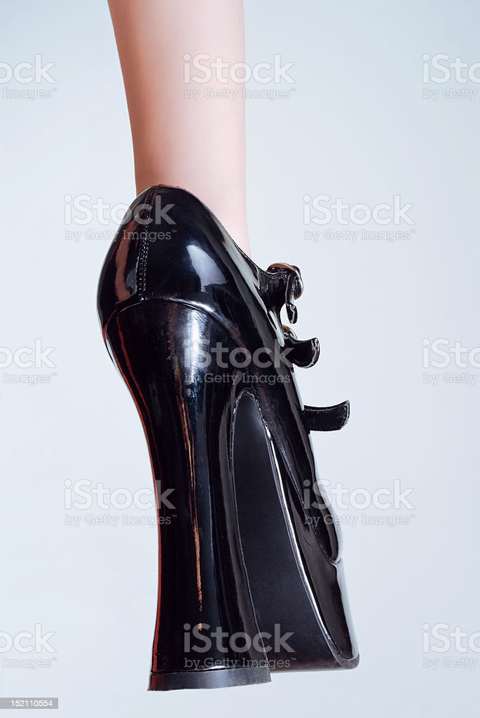 Black leather high-heel shoe royalty-free stock photo