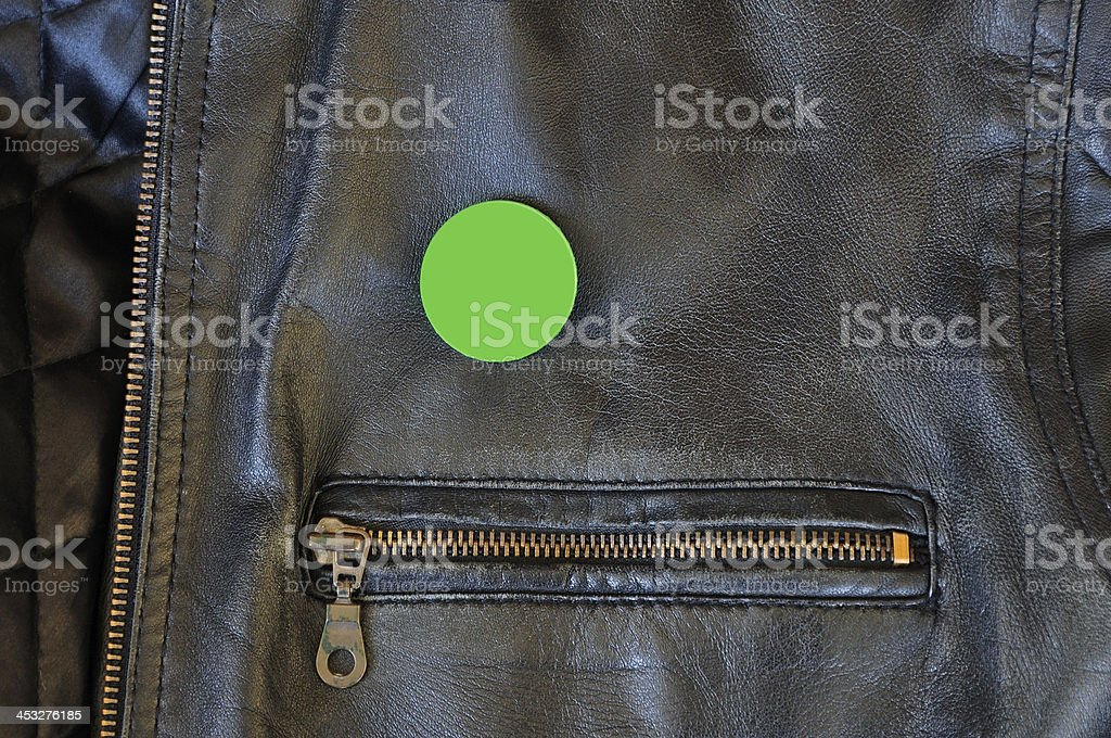 black leather jacket with pin badge stock photo