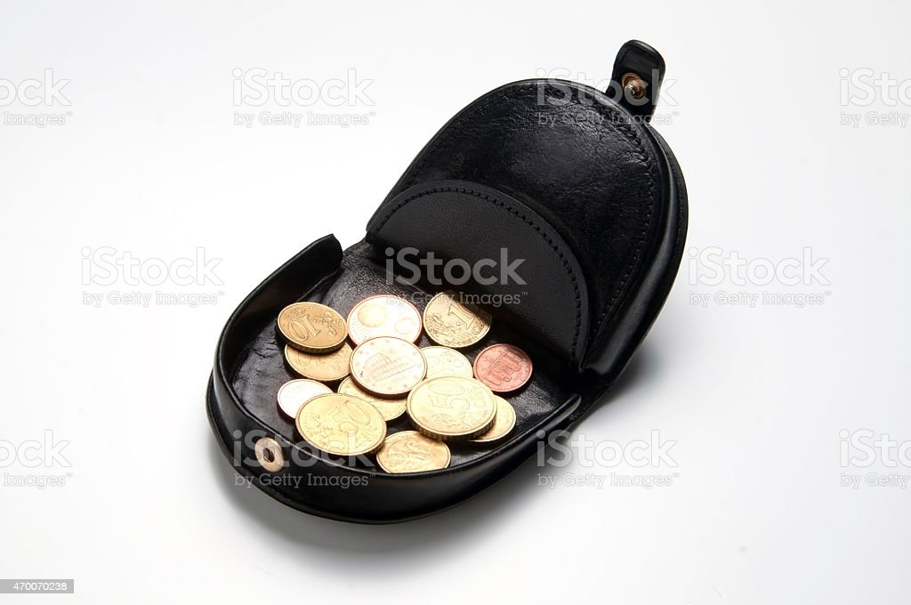 Black leather purse and coins stock photo