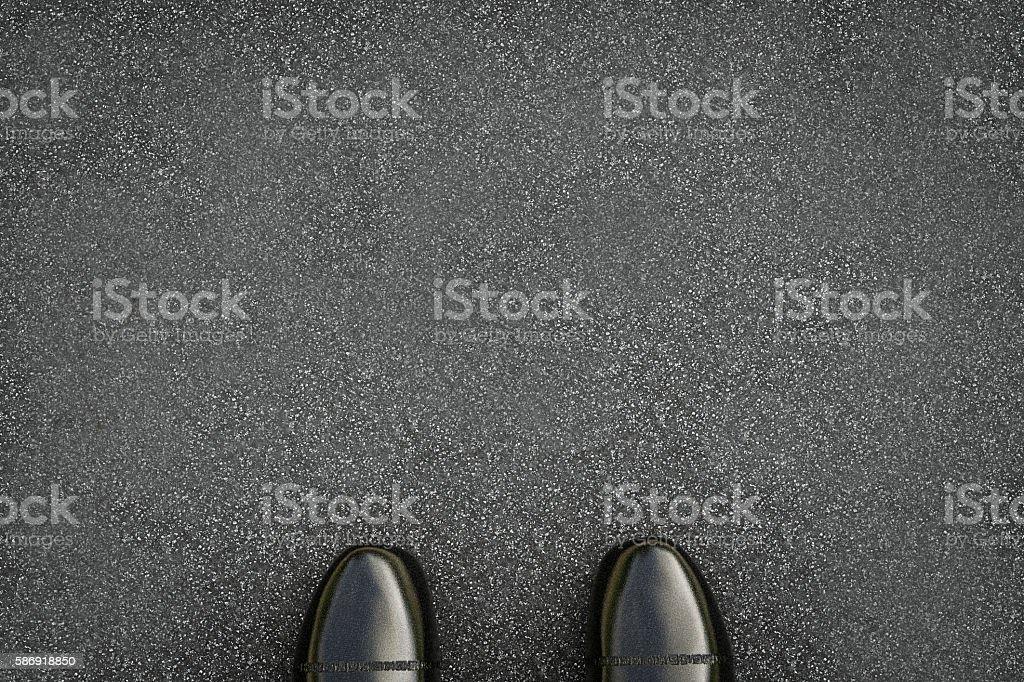 black leather shoes on asphalt background stock photo