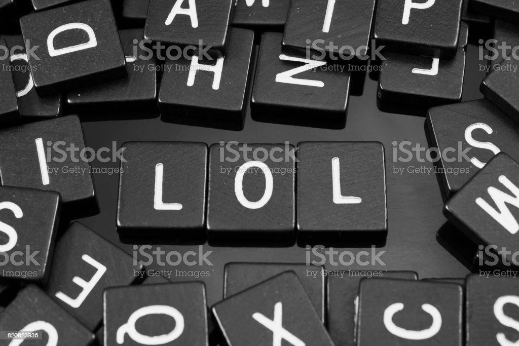 Black letter tiles spelling the word 'lol' stock photo