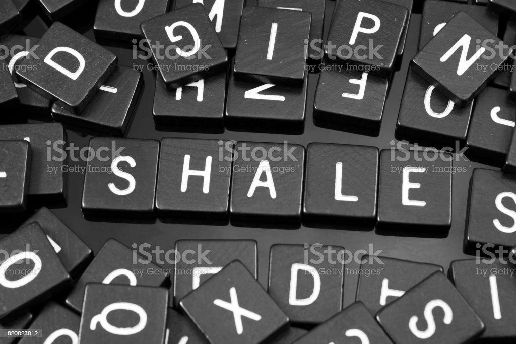 Black letter tiles spelling the word 'shale' stock photo