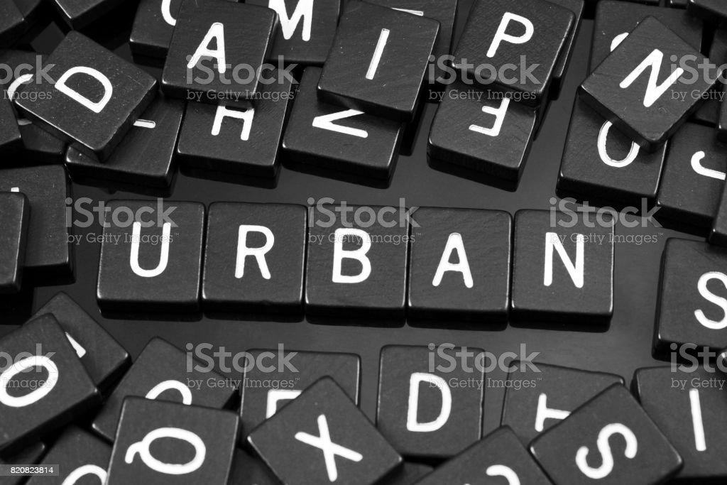 Black letter tiles spelling the word 'urban' stock photo