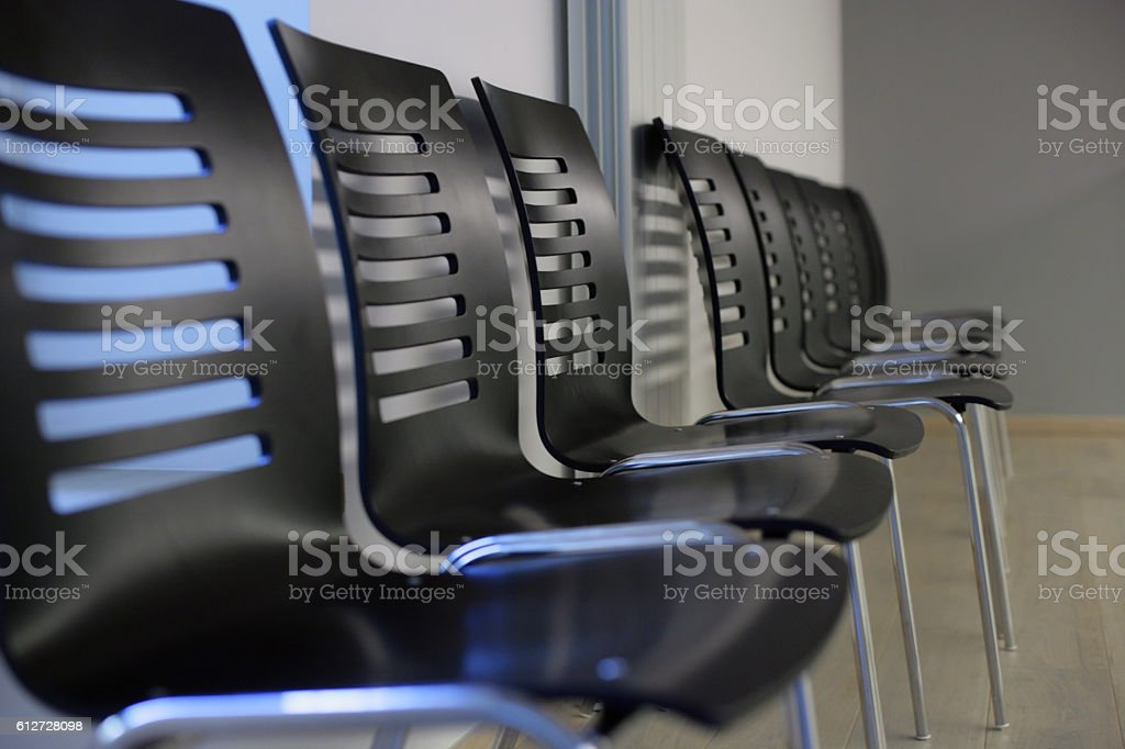 Black light plastic chairs stock photo