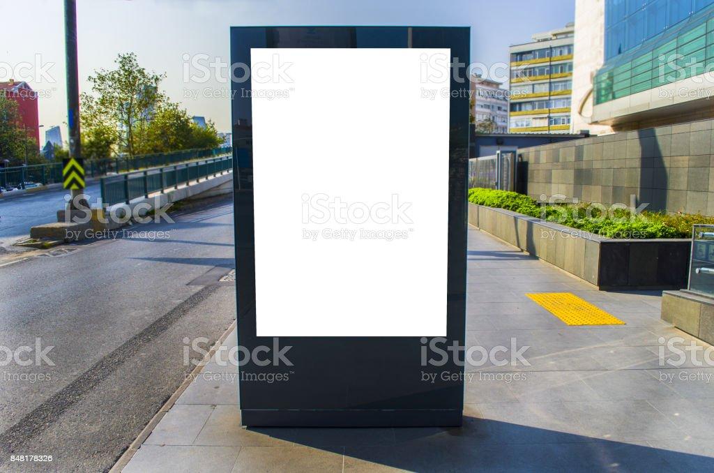 Black lightbox on the city street. Wood facades of modern stock photo