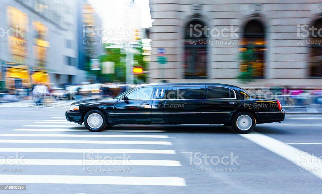 Black Limousine speeding in New York City stock photo