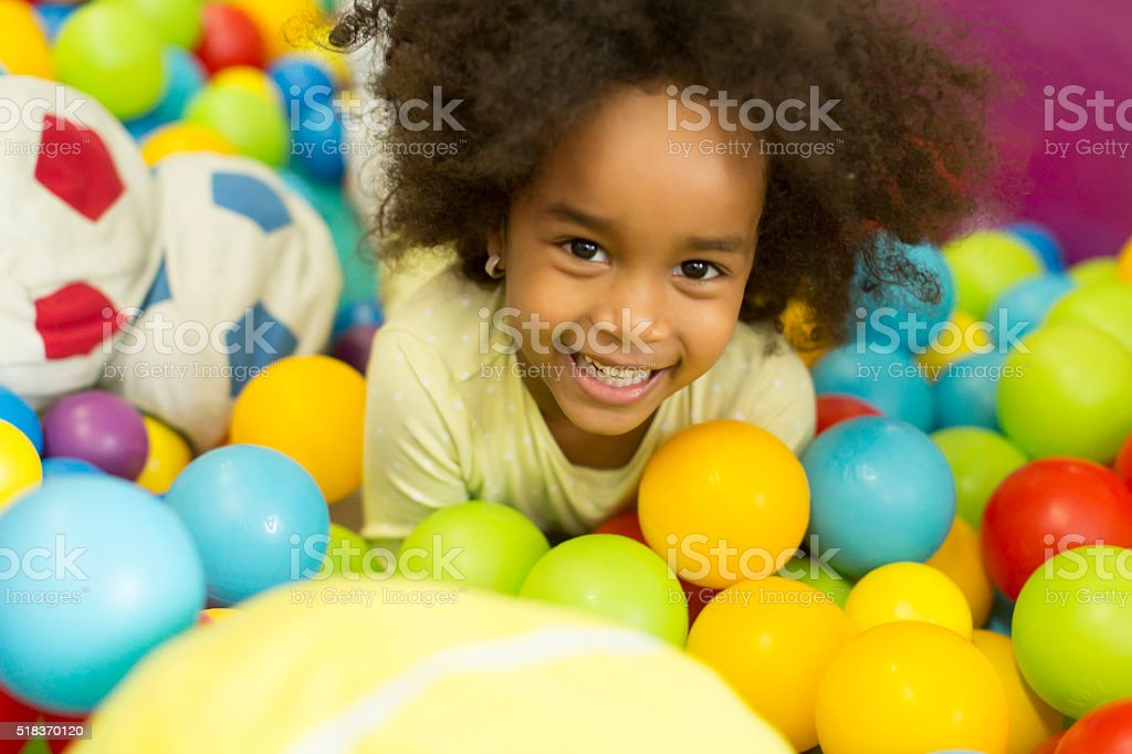 Black little girls in the playroom stock photo