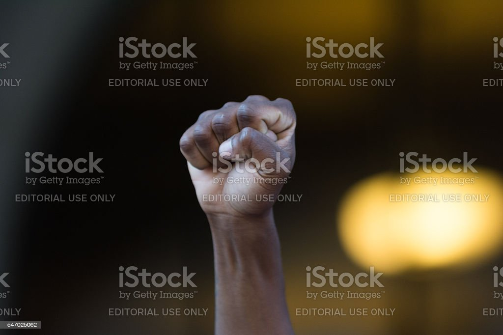 Black lives matter protestor put their fists in the air stock photo