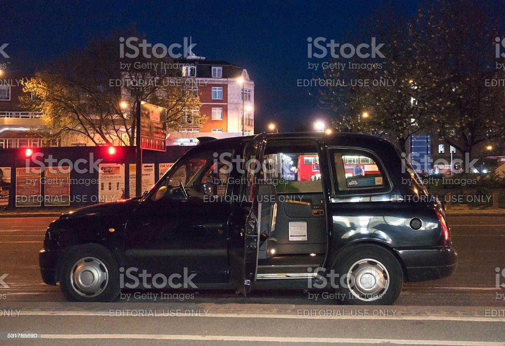 Black London cab waiting on the street stock photo