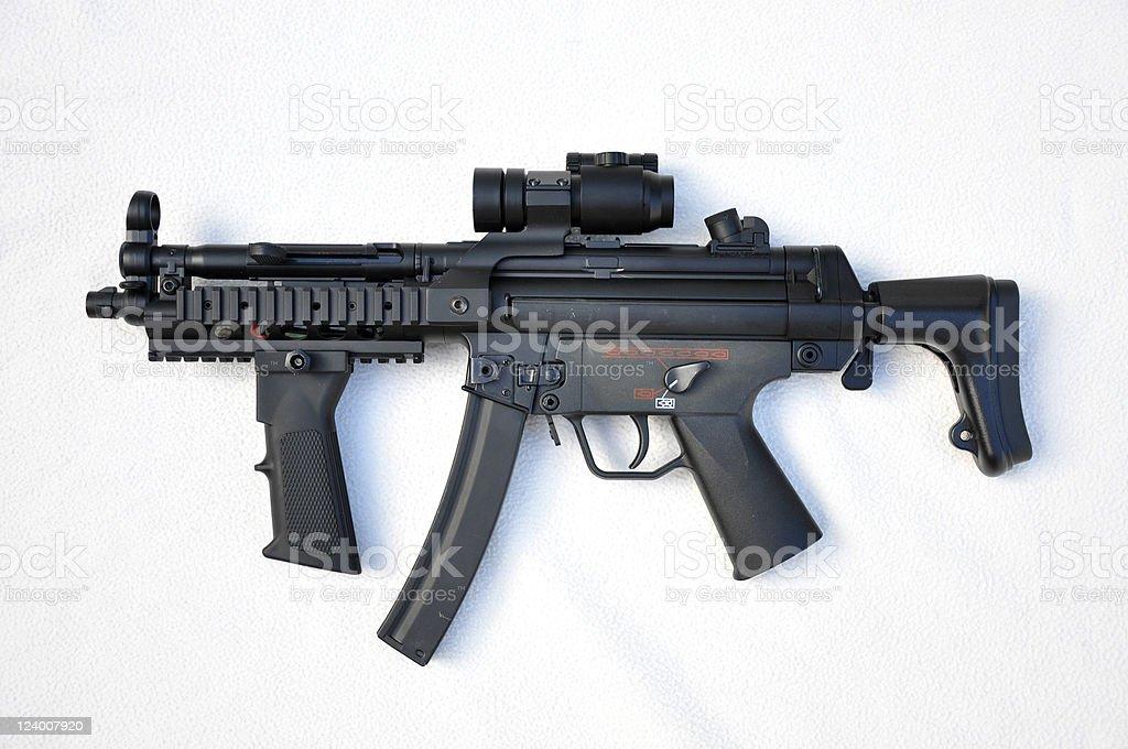 A black machine gun on a white background stock photo
