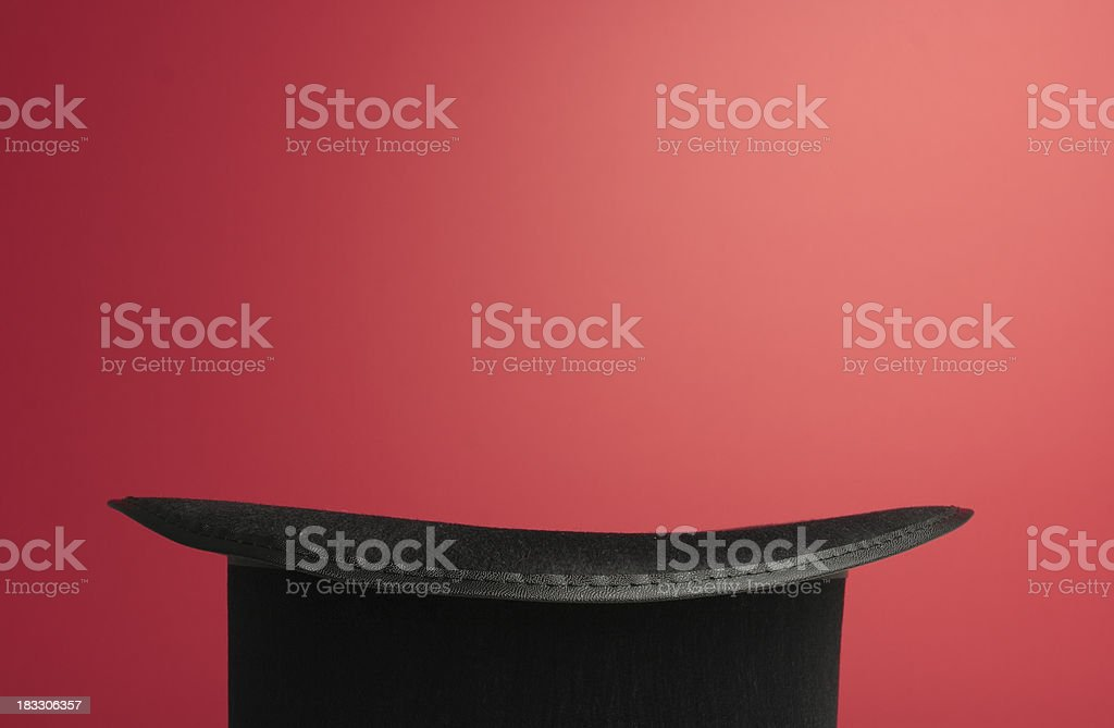 Black Magic Top Hat on Red with Space for Copy royalty-free stock photo
