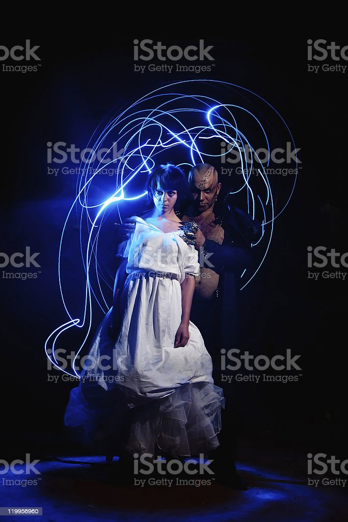 Black Magician with the beautiful girl royalty-free stock photo
