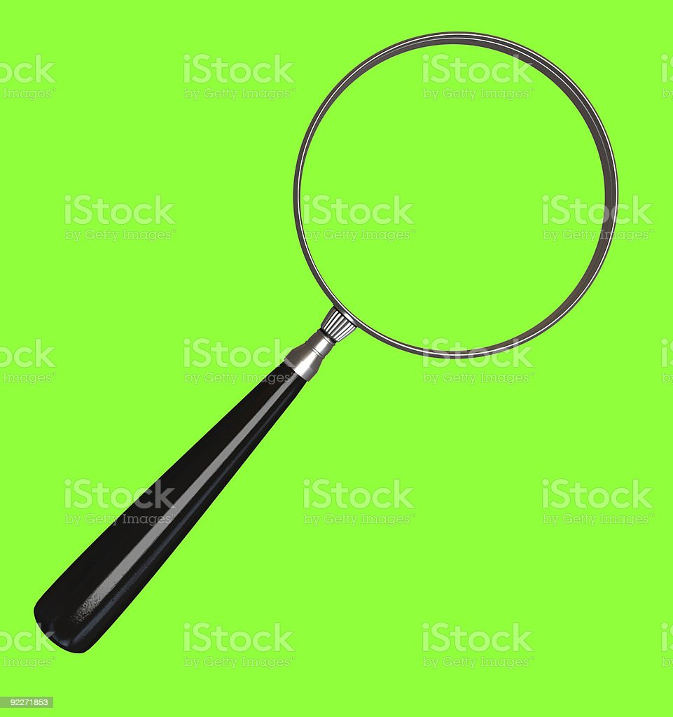 Black magnifying glass on green stock photo