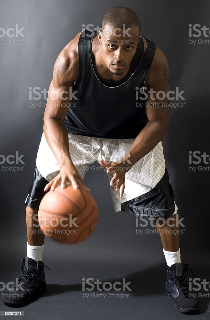 Black Male Basketball Player Dribbling The Ball royalty-free stock photo
