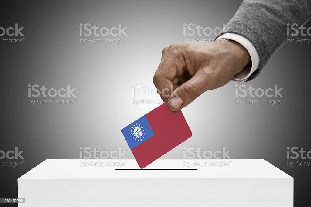 Black male holding flag - Union of Myanmar stock photo