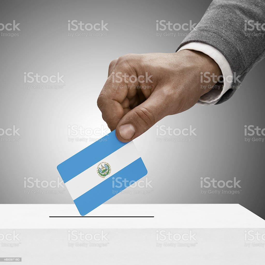 Black male holding flag. Voting concept - El Salvado stock photo