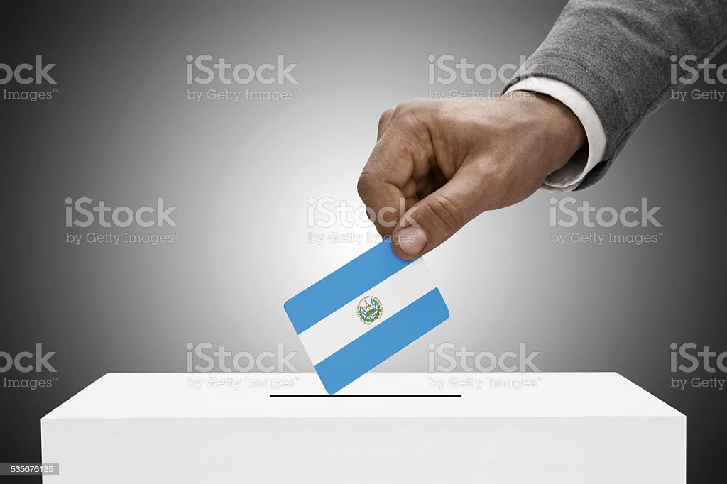 Black male holding flag. Voting concept - El Salvador stock photo