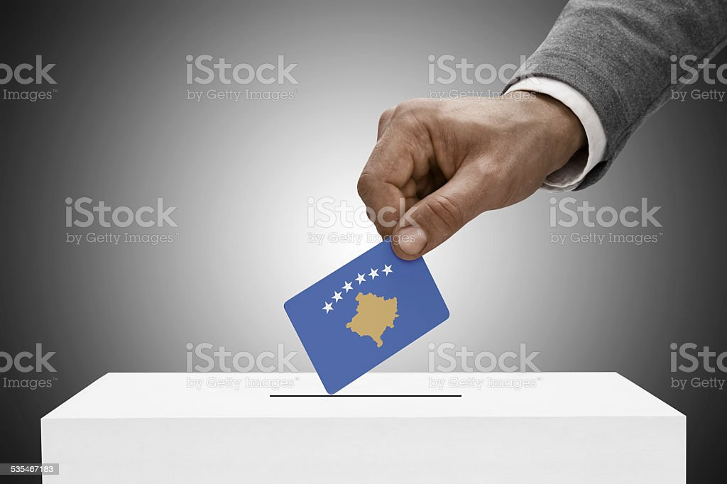 Black male holding flag. Voting concept - Kosovo stock photo