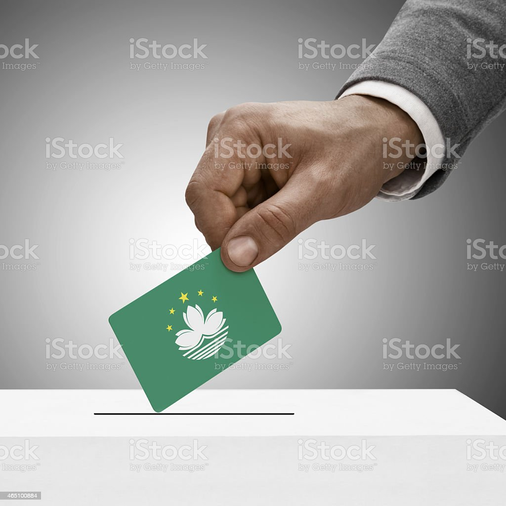 Black male holding flag. Voting concept - Macau stock photo