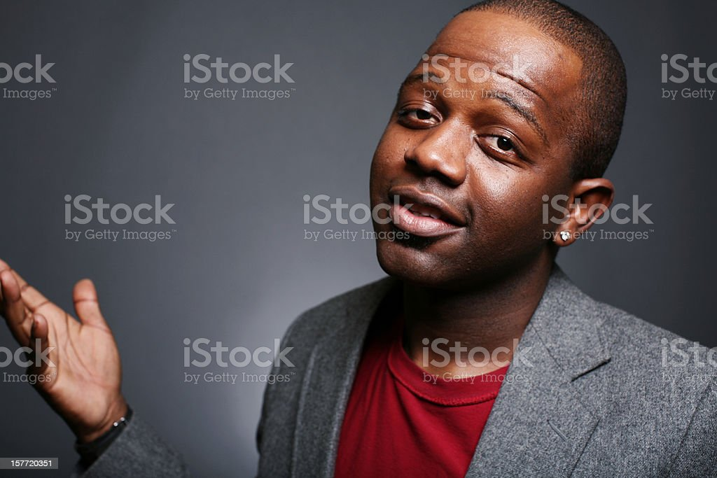 Black Male in Grey Suit and Red Shirt royalty-free stock photo