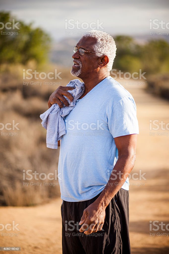 Black Man drying off with towel stock photo