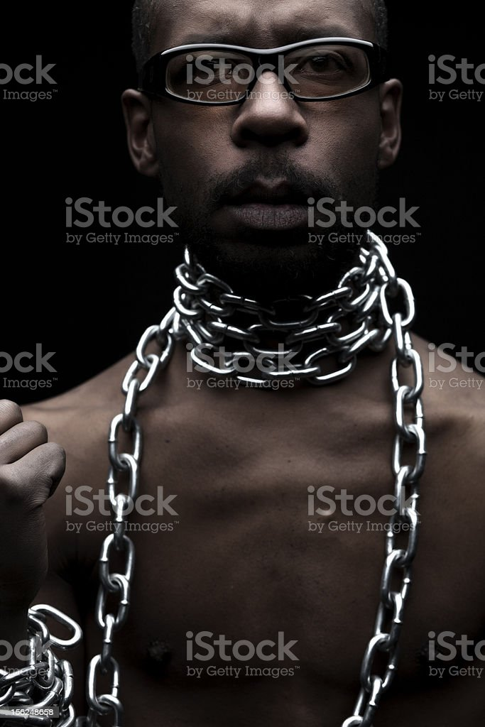 Black Man in Chains stock photo
