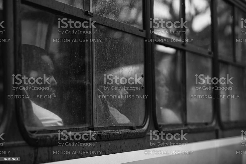 Black man looking out a bus window royalty-free stock photo