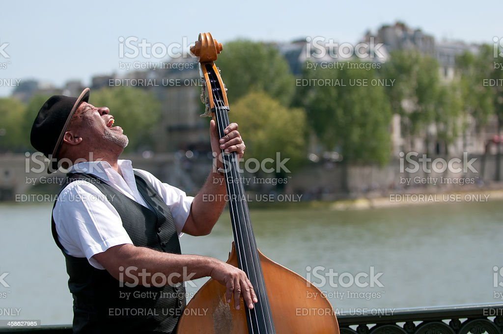 Black man playing an acoustic bass stock photo