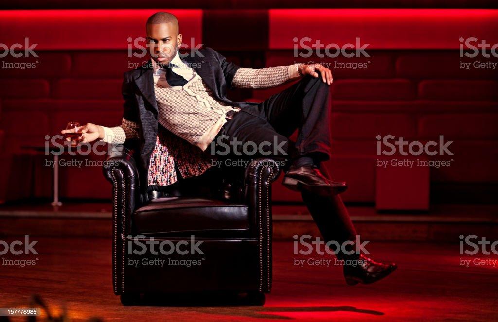 black man posing at the night club stock photo