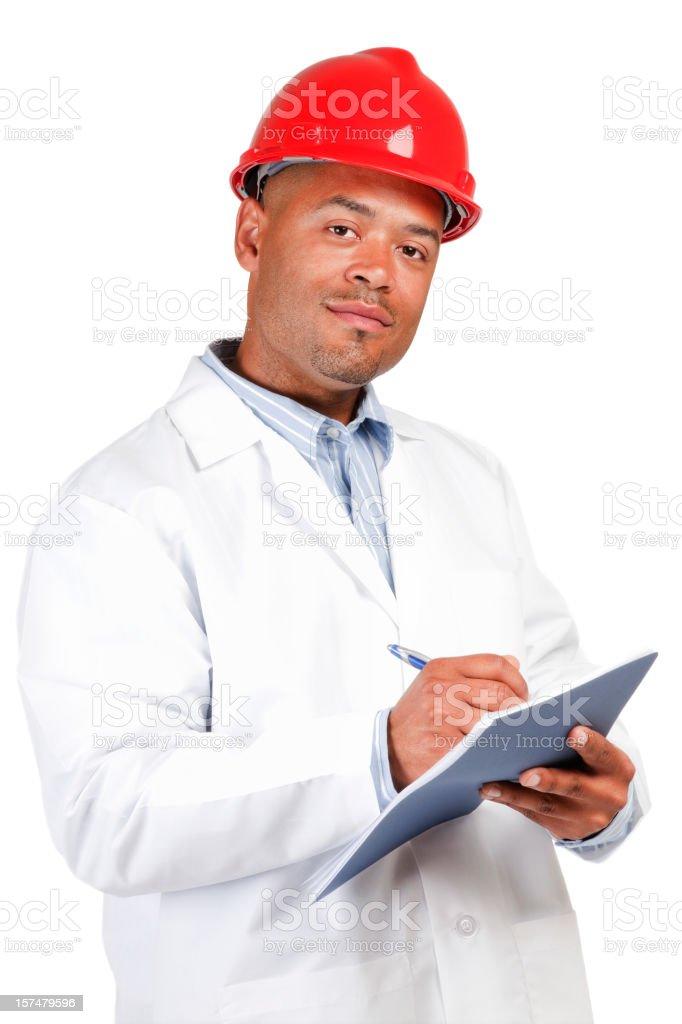 Black man red hard hat white lab coat writing isolated royalty-free stock photo