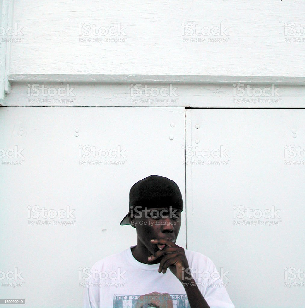 black man smoking royalty-free stock photo