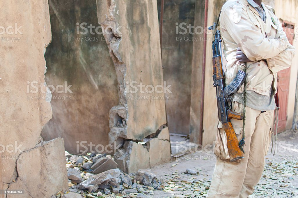 Black man stand with an AK 47 gun stock photo